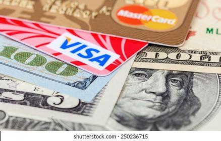 SAMARA, RUSSIA - FEBRUARY 4, 2015: Photo of VISA and Mastercard credit card with american dollars