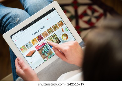 Samara, Russia - January 08, 2015: Close up of pinterest website on a ipad screen. pinterest announces a new application for mobile devices. Food and drink page