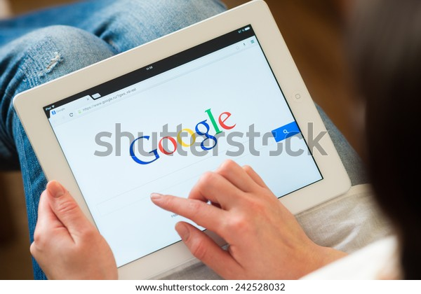 Samara, Russia - January 08, 2015: A Google search home page on a ipad screen, new app for mobile devices