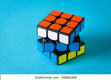 Samara, Russia, January 15 2017: Rubik's cube with unusual colors on azure background. It was invented by Hungarian architect Erno Rubik in 1974 .