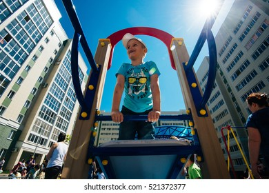 Samara, Russia - july 01, 2016: Children and their parents have fun on the playground of a modern living complex