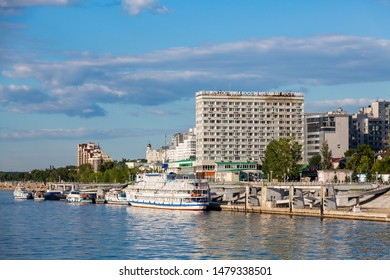 "Samara / Russia - July 1, 2019: River pier, Volga embankment in the city of Samara. Passenger ships at the pier. City architecture, hotel ""Russia"". On a Sunny summer day."
