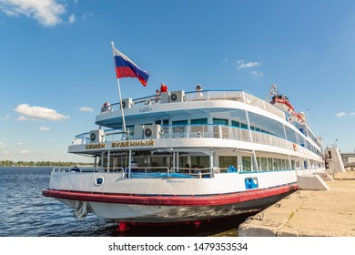 "Samara / Russia - July 2, 2019: Four-deck river cruise liner ""Semyon Budenny"" at the pier in the city of Samara. On a Sunny summer day."