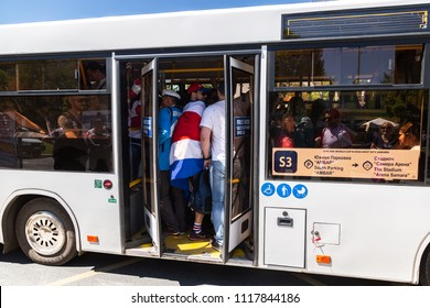 Samara, Russia - June 17, 2018: Shuttle bus with football fans on city street during the 2018 World Cup