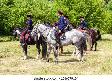 Samara, Russia - June 18, 2016: Young cossacks in traditional uniform on the horses. Cossacks is traditional paramilitary community