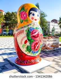 Samara, Russia - June 2, 2018: Sale of traditional russian souvenirs on the city embankment. Big doll matryoshka. Text in Russian: Samara souvenirs