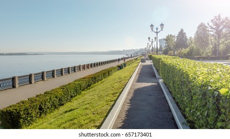 Samara, Russia - June 2017 - Volga River and the embankment of Samara, Russia. Samara embankment in summer. People walking in the alley.