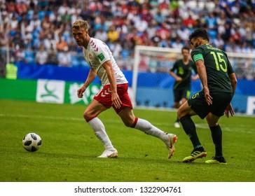 Samara, Russia - June 21, 2018. Danish striker Nicolai Jorgensen against Australian team captain Mile Jedinak during FIFA World Cup 2018 match Denmark vs Australia.