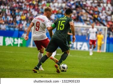 Samara, Russia – June 21, 2018. Danish striker Nicolai Jorgensen against Australian team captain Mile Jedinak during FIFA World Cup 2018 match Denmark vs Australia.
