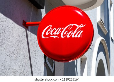 Samara, Russia - June 23, 2018: Coca Cola advertising sign on the wall of building