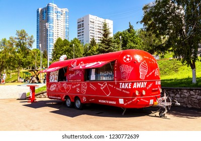 Samara, Russia - June 23, 2018: Food truck, mobile drink and snack van in a city street in summer sunny day