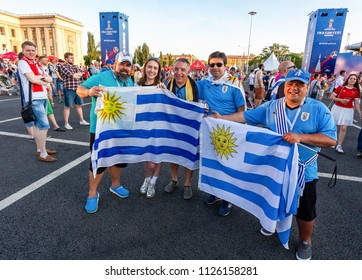 Samara, Russia - June 24, 2018: Football fans with flags of Uruguay in the fan zone at the central square