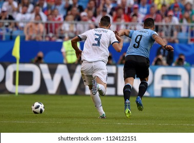 Samara, Russia - June 25, 2018. Uruguayan striker Luis Suarez and Russian defender Ilya Kutepov during FIFA World Cup 2018 match Uruguay vs Russia