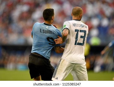 Samara, Russia - June 25, 2018. Russian defender Fedor Kudryashov and Uruguayan striker Luis Suarez during FIFA World Cup 2018 match Uruguay vs Russia.
