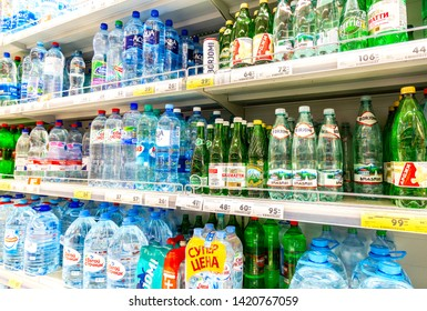Samara, Russia - June 9, 2019: Different bottled fresh cool water ready for sale in supermarket