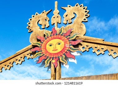Samara, Russia - March 17, 2018: Shrovetide in Russia. Big improvised sun against the blue sky. Maslenitsa or Pancake Week is the Slavic Holiday that dates back to the pagan times
