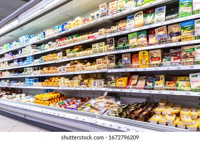 Samara, Russia - March 19, 2017: Various packaged cheese for sale on the superstore shelves