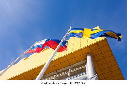 SAMARA, RUSSIA - MARCH 9, 2014: Flags of Russia and Sweden near IKEA Samara Store. IKEA is the world's largest furniture retailer and sells ready to assemble furniture.