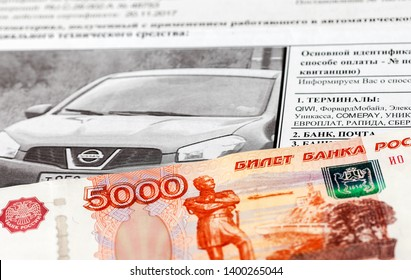 Samara, Russia - May 10, 2018: Receipt for payment of a fine for violation of traffic rules and banknote