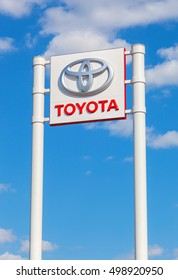 SAMARA, RUSSIA - MAY 11, 2016: Toyota automotive dealership sign against the blue sky background. Toyota is the world's market leader in sales of hybrid electric vehicles