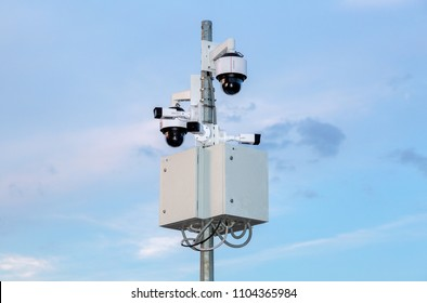 Samara, Russia - May 16, 2018: Surveillance CCTV cameras mounted on post against the blue sky