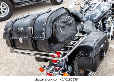 Samara, Russia - May 18, 2019: Leather motorcycle bag for carrying luggage. Motorcycle with Leather Saddlebag Trunk Bag Luggage