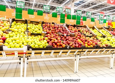 Samara, Russia - May 26, 2019: Fresh apples ready for sale in Auchan Samara Store. French distribution network Auchan unites more than 1300 shops
