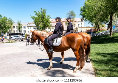 Samara, Russia - May 27, 2018: Female mounted police on horse back at the city street