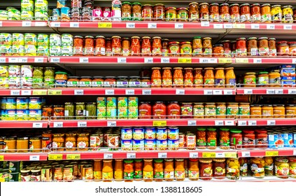 Samara, Russia - May 3, 2019: Canned fruits and vegetables in cans on the shelves in a grocery store