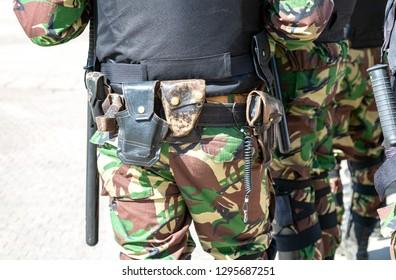 Samara, Russia - May 5, 2018: Russian policeman with gun belt, handcuffs gun, shoker and holster