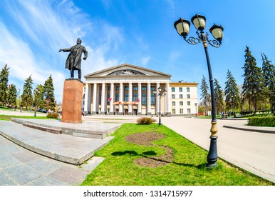 Samara, Russia - May 6, 2018: Monument to soviet statesman S. M. Kirov in front of Palace of culture on the same city square. Fisheye view