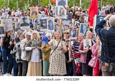 SAMARA, RUSSIA - MAY 9, 2017:  Procession of the people in Immortal Regiment on annual Victory Day, May, 9, 2017 in Samara, Russia