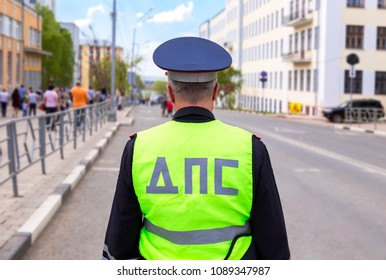 Samara, Russia - May 9, 2018: Russian police patrol officer of the State Automobile Inspectorate regulate traffic on city street