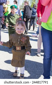 SAMARA, RUSSIA - MAY 9: Russian girl at the parade on annual Victory Day, May, 9, 2014 in Samara, Russia.