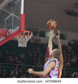 SAMARA, RUSSIA - NOVEMBER 07: Nikita Balashov of BC Krasnye Krylia throws a ball in a basket during a BC KERAVNOS STROVOLOU game on November 07, 2012 in Samara, Russia.