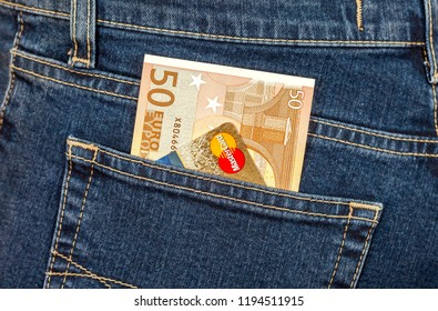Samara, Russia - November 24, 2017: Banknote 50 euro and credit card Mastercard sticking out of the jeans pocket