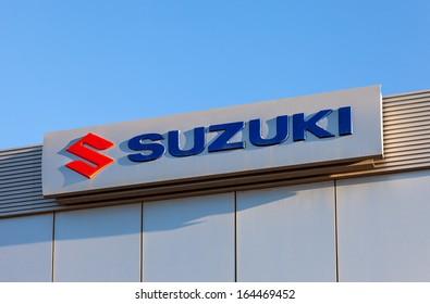 SAMARA, RUSSIA - NOVEMBER 24: The emblem Suzuki over blue sky, November 24, 2013 in Samara, Russia. Suzuki Motor Corporation is a Japanese multinational corporation