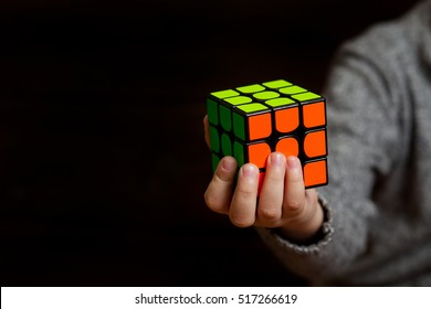 Samara, Russia, November 9 2016: Rubik's cube in the hands of a child close up. It was invented by Hungarian architect Erno Rubik in 1974.