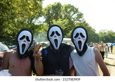 """Samara, Russia, October, 10, 2019: a friendly company celebrates Halloween in """"Scream"""" masks against the background of nature"""