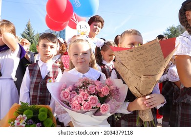 Samara, Russia, September, 1, 2021: First-graders at the solemn line-up on September 1 in Russia