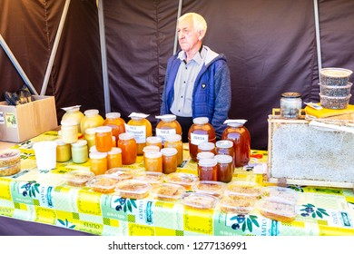 Samara, Russia - September 15, 2018: Sweet fresh honey ready for sale at the traditional farmers market