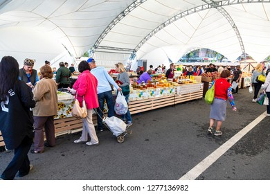 Samara, Russia - September 22, 2018: Sweet fresh honey and other produce selling at the traditional farmers market