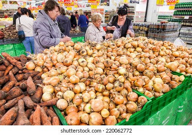 SAMARA, RUSSIA - SEPTEMBER 23, 2014: Buyers select fresh vegetables in supermarket Magnit. Russia's largest retailer