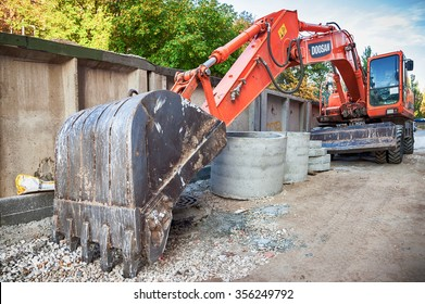 SAMARA, RUSSIA - SEPTEMBER 26, 2015: Doosan wheel excavator parked on the street in summer day