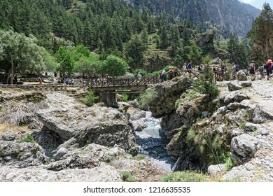 Samaria, Crete / GREECE May 25 2017: Samaria Gorge landscape at Crete, Greece. People hiking along the trail through the canyon and visiting the old village Samaria.