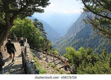 Samaria, Crete / GREECE May 25 2017: People hiking on trail through Samaria gorge. (Crete, Greece).
