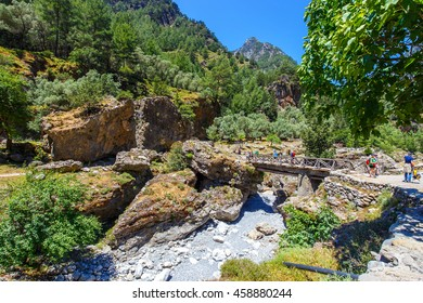 Samaria Gorge, Greece - MAY 26, 2016: Tourists hike in Samaria Gorge in central Crete, Greece. The national park is a UNESCO Biosphere Reserve since 1981
