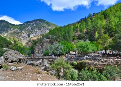 SAMARIA, GREECE - SEPTEMBER 23, 2016: Tourists visit the displaced village Samaria in Samaria Gorge in Crete island. The national park is a UNESCO Biosphere Reserve since 1981.