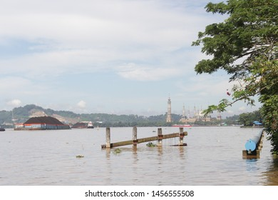 Samarinda, East Kalimantan, Indonesia - March 4, 2018: Summer, clear sky morning activities of tugboats and barges for coal mining distribution on the Mahakam river, Samarinda, East Kalimantan.