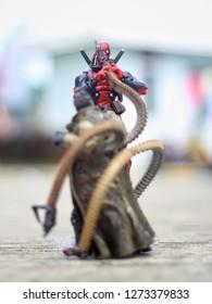 SAMARINDA INDONESIA - November 21 ,2017 : Close up shot of Deadpool vs Doctor Octopus in Fight. Superheros figure in action